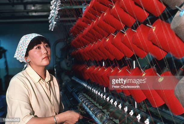 Ulan Bator ULAN BATOR Mongolia A worker at the state run Gobi factory which makes cashmere and camelhair garments checks machinery The factory was...