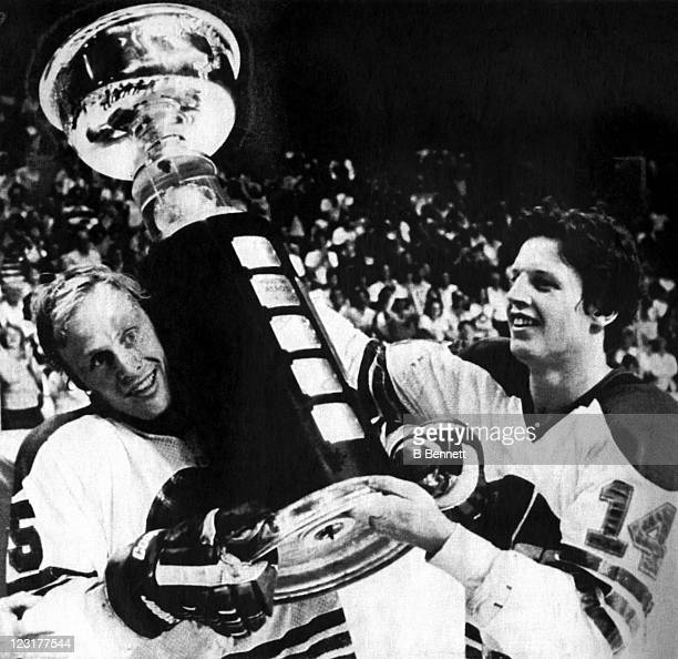 Ulf Nilssen and Anders Hedberg of the Winnipeg Jets hold up the Avco World Trophy after the Jets defeated the New England Whalers in Game 4 of the...