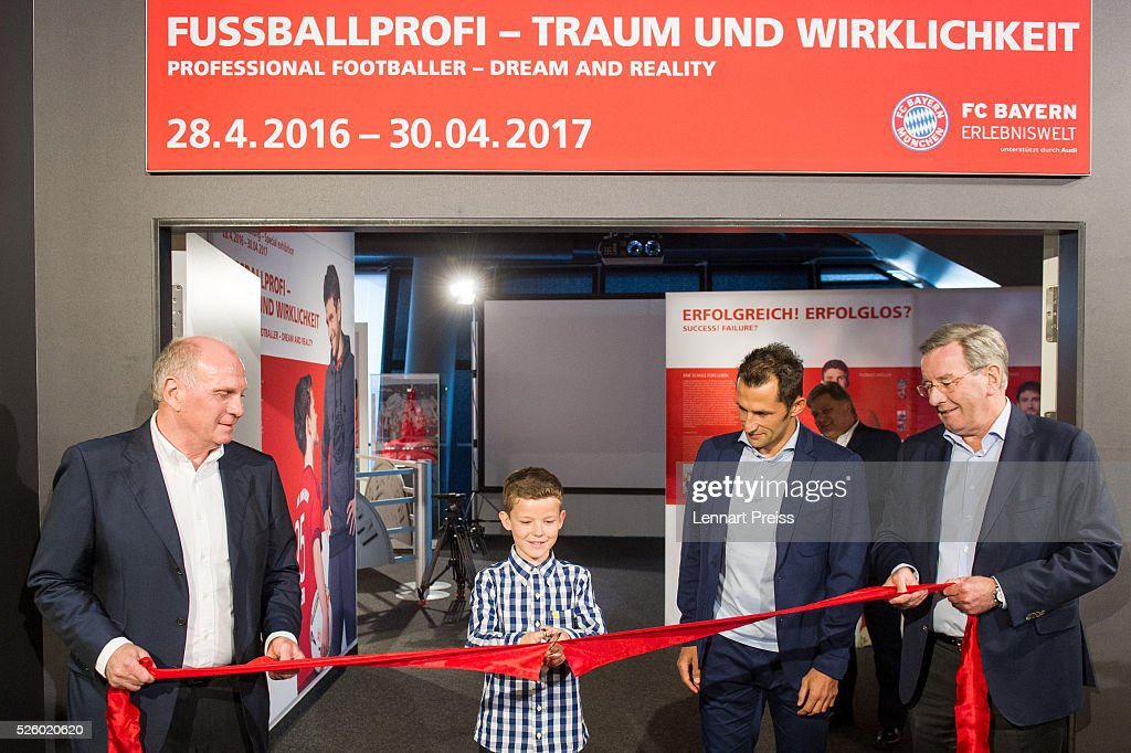 Uli Hoeness (L-R), former president of FC Bayern Muenchen, ten-year old Jannis, youth player of FC Bayern Muenchen, Hasan Salihamidzic, former player of FC Bayern Muenchen and Karl Hopfner, president of FC Bayern Muenchen cut the ribbon during the opening of the exhibition 'Professional Football Player - Dream And Reality' at FCB Erlebniswelt on April 29, 2016 in Munich, Germany.