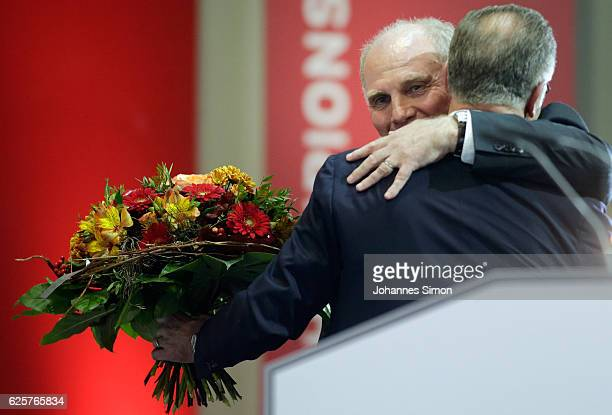 Uli Hoeness is hugged by GC Bayern CEO KarlHeinz Rummenigge during the annual general assembly of the FC Bayern Muenchen at AudiDome on November 25...