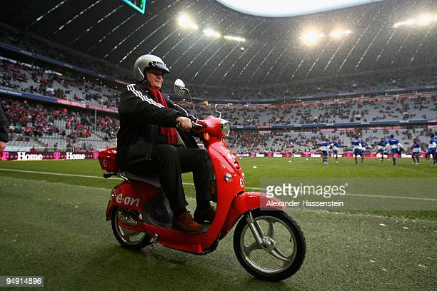 Uli Hoeness President of Bayern Muenchen arrives with a electro scooter prior to the Bundesliga match between Bayern Muenchen and Hertha BSC Berlin...