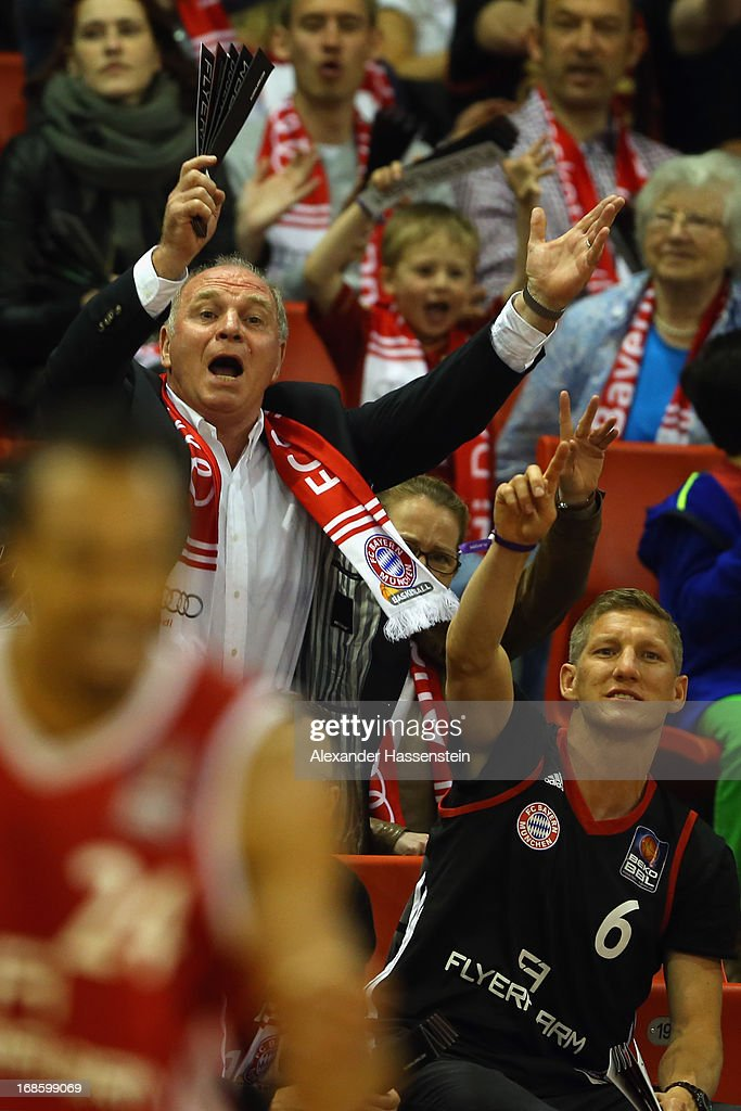 Uli Hoeness (L), President of Bayern Muenchen celebrates with his player <a gi-track='captionPersonalityLinkClicked' href=/galleries/search?phrase=Bastian+Schweinsteiger&family=editorial&specificpeople=203122 ng-click='$event.stopPropagation()'>Bastian Schweinsteiger</a> (R) during Game 3 of the quarterfinals of the Beko Basketball Playoffs between FC Bayern Muenchen and ALBA Berlin at Audi-Dome on May 12, 2013 in Munich, Germany.