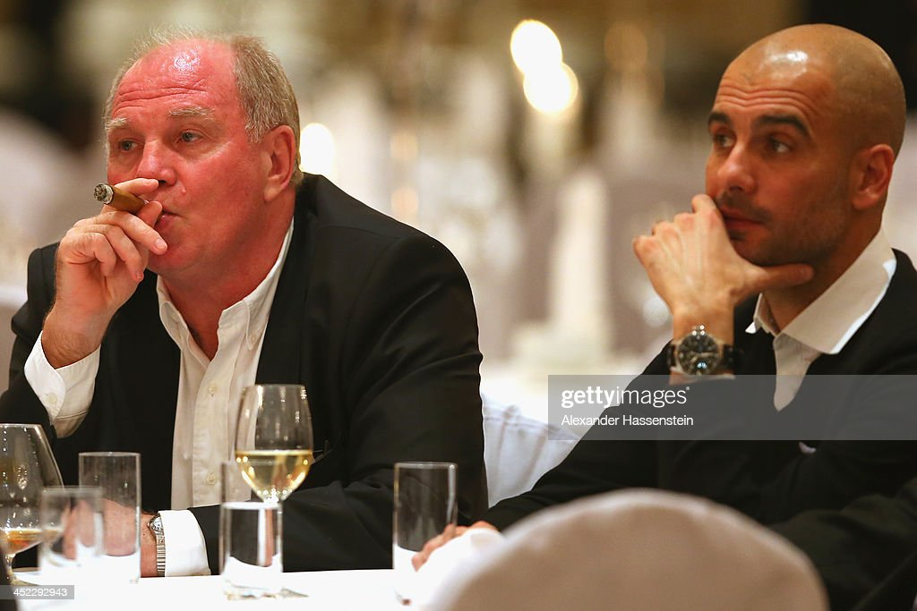 <a gi-track='captionPersonalityLinkClicked' href=/galleries/search?phrase=Uli+Hoeness&family=editorial&specificpeople=634868 ng-click='$event.stopPropagation()'>Uli Hoeness</a>, President of Bayern Muenchen enjoys a cigar beside head coach <a gi-track='captionPersonalityLinkClicked' href=/galleries/search?phrase=Josep+Guardiola&family=editorial&specificpeople=2088964 ng-click='$event.stopPropagation()'>Josep Guardiola</a> (R) during the Champions Dinner at RitzCarlon Hotel Moscow after winning UEFA Champions League Group D match between PFC CSKA Moskva and FC Bayern Muenchen on November 27, 2013 in Moscow, Russia.