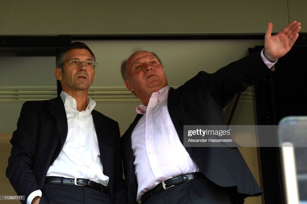 Uli Hoeness (R), President of Bayern Muenchen talks to <a gi-track='captionPersonalityLinkClicked' href=/galleries/search?phrase=Herbert+Hainer&family=editorial&specificpeople=543915 ng-click='$event.stopPropagation()'>Herbert Hainer</a>, CEO of adidas group prior the presentation of the new FC Bayern Muenchen home jersey for the season 2011/12 at Allianz Arena on April 19, 2011 in Munich, Germany.