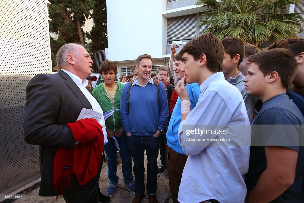 <a gi-track='captionPersonalityLinkClicked' href=/galleries/search?phrase=Uli+Hoeness&family=editorial&specificpeople=634868 ng-click='$event.stopPropagation()'>Uli Hoeness</a> (L), President of Bayern Muenchen talks to students at the German School Valencia on November 20, 2012 in Valencia, Spain.