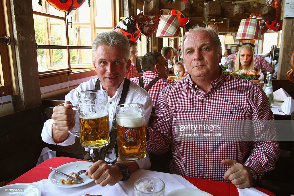 <a gi-track='captionPersonalityLinkClicked' href=/galleries/search?phrase=Uli+Hoeness&family=editorial&specificpeople=634868 ng-click='$event.stopPropagation()'>Uli Hoeness</a> (R) President of FC Bayern Muenchen attends with head coach <a gi-track='captionPersonalityLinkClicked' href=/galleries/search?phrase=Jupp+Heynckes&family=editorial&specificpeople=2062040 ng-click='$event.stopPropagation()'>Jupp Heynckes</a> the Oktoberfest beer festival at the Kaefer Wiesnschaenke tent on October 2, 2011 in Munich, Germany.