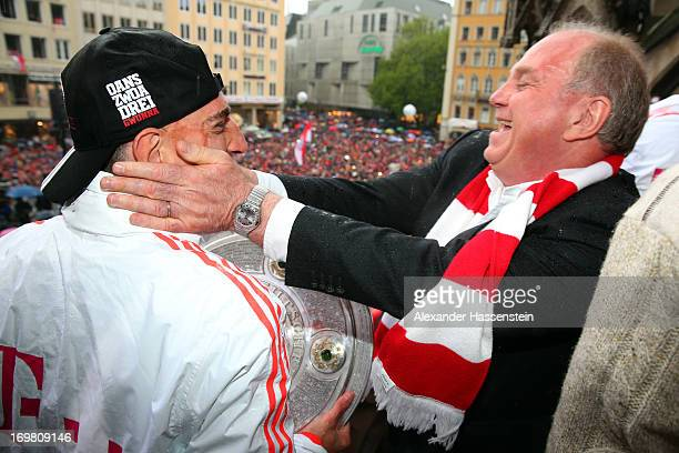 Uli Hoeness President of FC Bayern Muenchen celebrate winning Bundesliga trophy with his player Franck Ribery on the town hall balcony at Marienplatz...