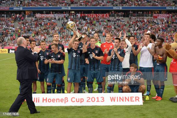 Uli Hoeness president of FC Bayern Muenchen hands over the trophy to the team of Muenchen after the Uli Hoeness Cup match between FC Bayern Muenchen...