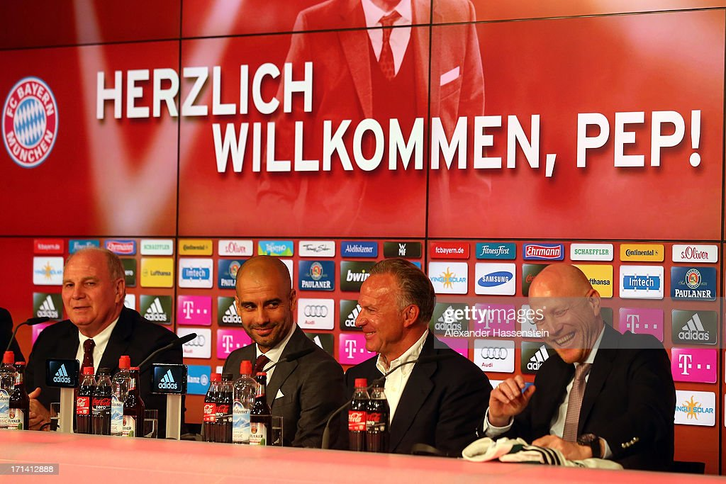 Uli Hoeness, president of FC Bayern Muenchen, Josep Guardiola, new head coach of FC Bayern Muenchen, Karl-Heinz Rummenigge, CEO of FC Bayern Muenchen and Matthias Sammer, senior executive president sport of FC Bayern Muenchen (L-R) react during the official presentation of Josep Guardiola as new head coach of FC Bayern Muenchen at the Allianz Arena on June 24, 2013 in Munich, Germany.