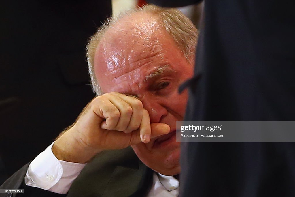 <a gi-track='captionPersonalityLinkClicked' href=/galleries/search?phrase=Uli+Hoeness&family=editorial&specificpeople=634868 ng-click='$event.stopPropagation()'>Uli Hoeness</a>, President of FC Bayern Muenchen reacts during the FC Bayern Muenchen annual general meeting at Audi Dome on November 13, 2013 in Munich, Germany.