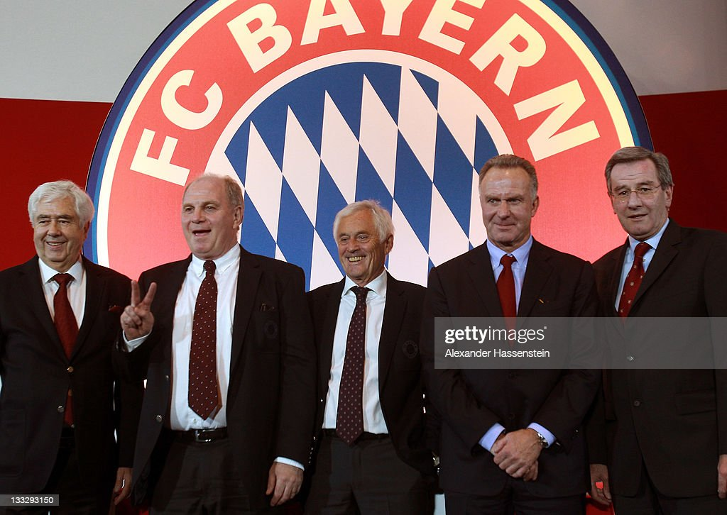 <a gi-track='captionPersonalityLinkClicked' href=/galleries/search?phrase=Uli+Hoeness&family=editorial&specificpeople=634868 ng-click='$event.stopPropagation()'>Uli Hoeness</a> (2 nd L), president of FC Bayern Muenchen reacts whilst vice president Fritz Scherer (L), vice president Bernd Rauch (C), CEO <a gi-track='captionPersonalityLinkClicked' href=/galleries/search?phrase=Karl-Heinz+Rummenigge&family=editorial&specificpeople=634867 ng-click='$event.stopPropagation()'>Karl-Heinz Rummenigge</a> (2nd R) and CFO <a gi-track='captionPersonalityLinkClicked' href=/galleries/search?phrase=Karl+Hopfner&family=editorial&specificpeople=635248 ng-click='$event.stopPropagation()'>Karl Hopfner</a> (R) pose during the FC Bayern Muenchen general meeting at Audi Dome on November 18, 2011 in Munich, Germany.