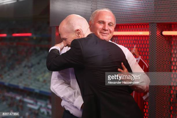 Uli Hoeness President of FC Bayern Muenchen reacts with Matthias Sammer at the Eurosport TV studio prior to the Bundesliga match between FC Bayern...