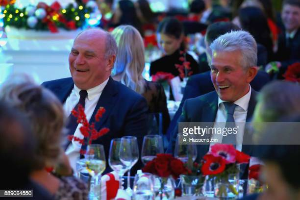 Uli Hoeness President of FC Bayern Muenchen smiles with head coach Jupp Heynckes during the FC Bayern Muenchen Christmas Party 2017 at Palais Lenbach...