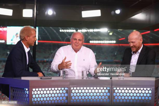 Uli Hoeness President of FC Bayern Muenchen talks to Jan henkel and Matthias Sammer at the Eurosport TV studio prior to the Bundesliga match between...