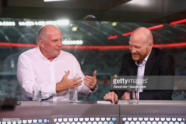 Uli Hoeness President of FC Bayern Muenchen talks to Matthias Sammer at the Eurosport TV studio prior to the Bundesliga match between FC Bayern...