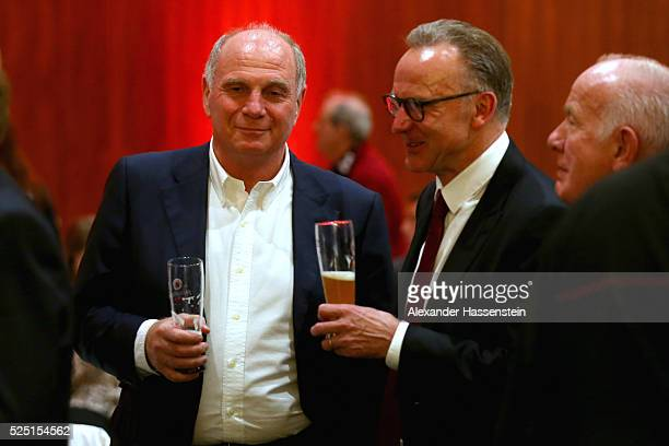 Uli Hoeness talks to KarlHeinz Rummenigge CEO of Bayern Muenchen during the Champions Banquette after the UEFA Champions League semi final first leg...