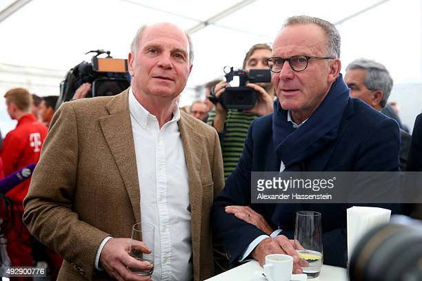 Uli Hoeness talks to KarlHeinz Rummenigge CEO of FC Bayern Muenchen during the FC Bayern Muenchen youth center for excellence ground breaking...