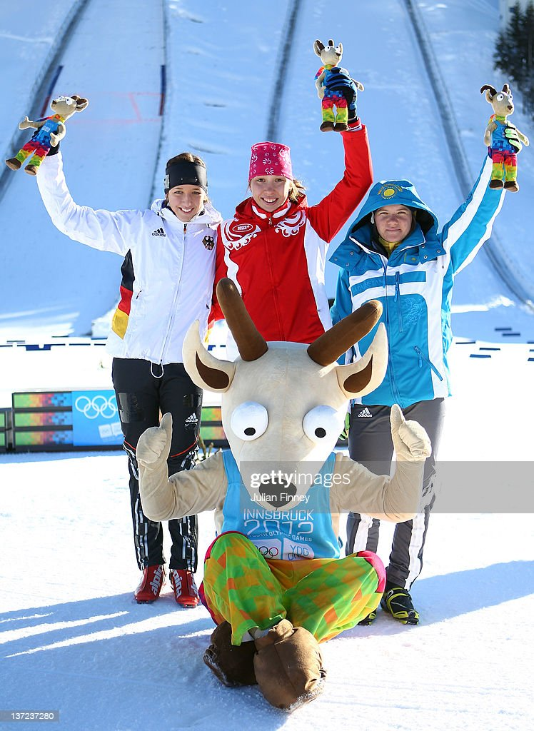 Uliana Kaysheva of Russia celebrates winning gold with Franziska Preuss of Germany taking silver (L), <a gi-track='captionPersonalityLinkClicked' href=/galleries/search?phrase=Galina+Vishnevskaya&family=editorial&specificpeople=911029 ng-click='$event.stopPropagation()'>Galina Vishnevskaya</a> of Kazakhstan with bronze and the mascot, Yoggl after the Women's 7.5km Pursuit Biathlon during the Winter Youth Olympic Games on January 16, 2012 in Seefeld, Austria.