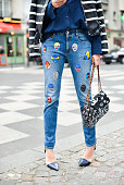 uliana Salazar poses wearing Each Other jacket Acne Studios shirt Stella McCartney pants Alexander Wang shoes and Chanel bag on Day 7 of Paris...