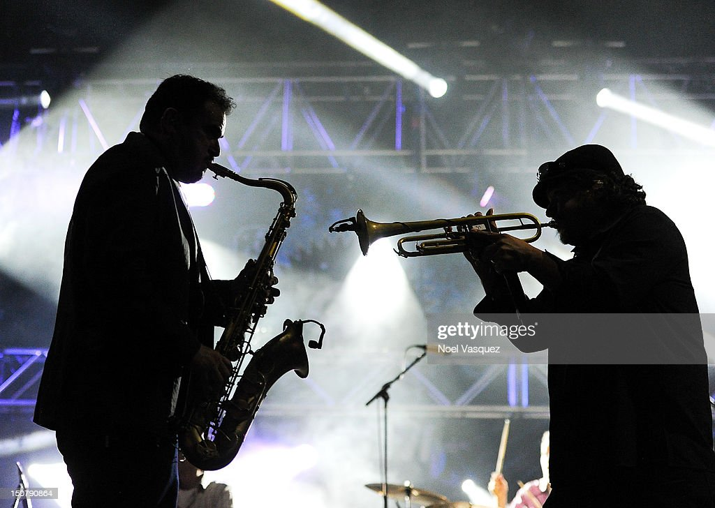 Ulises Bella and Asdru Sierra of Ozomatli perform at Univision Radio's H2O music festival at Los Angeles State Historic Park on August 25 2012 in Los...