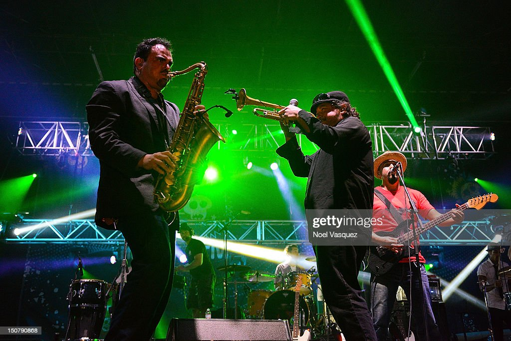 Ulises Bella Asdru Sierra and Raul Pacheco of Ozomatli perform at Univision Radio's H2O music festival at Los Angeles State Historic Park on August...