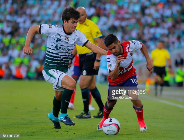 Ulises Rivas of Santos and Daniel Villava of Veracruz fight for the ball during the 4th round match between Santos Laguna and Veracruz as part of the...
