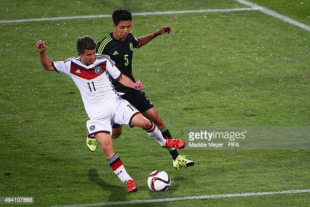 Ulises Torres of Mexico and Mats Kohlert of Germany vie for the ball during the FIFA U17 World Cup Chile 2015 Group C match between Germany and...