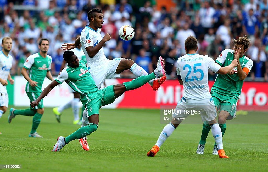 Ulisses Garcia of Bremen and Eric Maxim Choupo Moting of Schalke battle for the ball during the Bundesliga match between SV Werder Bremen and Schalke...