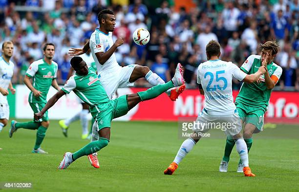 Ulisses Garcia of Bremen and Eric Maxim Choupo Moting of Schalke battle for the ball during the Bundesliga match between SV Werder Bremen and Schalke...