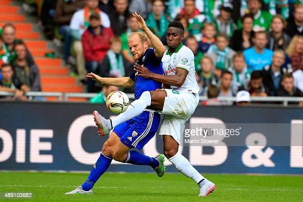 Ulisses Garcia of Bremen challenges Tobias Levels of Ingolstadt during the Bundesliga match between Werder Bremen and FC Ingolstadt at Weserstadion...