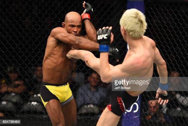 Ulka Sasaki of Japan kicks Wilson Reis of Brazil in their flyweight bout during the UFC 208 event inside Barclays Center on February 11 2017 in...