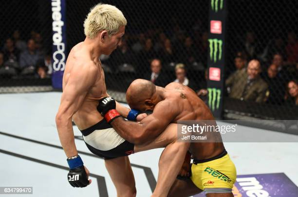 Ulka Sasaki of Japan knees Wilson Reis of Brazil in their flyweight bout during the UFC 208 event inside Barclays Center on February 11 2017 in...