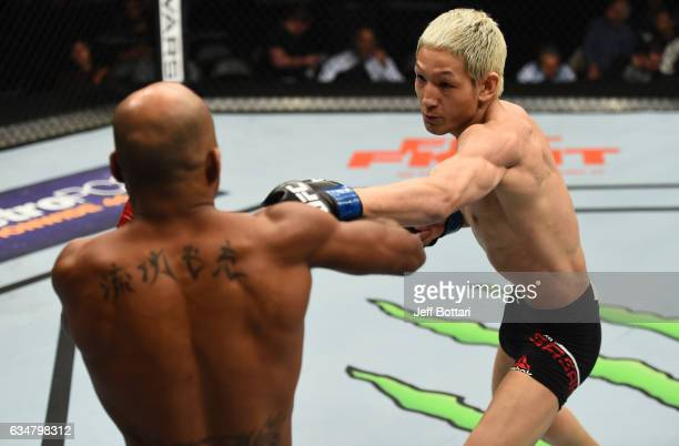 Ulka Sasaki of Japan punches Wilson Reis of Brazil in their flyweight bout during the UFC 208 event inside Barclays Center on February 11 2017 in...