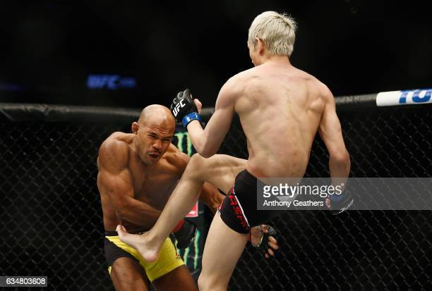 Ulka Sasaki of Japan throws a kick against Wilson Reis of Brazil in their flyweight bout during UFC 208 at the Barclays Center on February 11 2017 in...