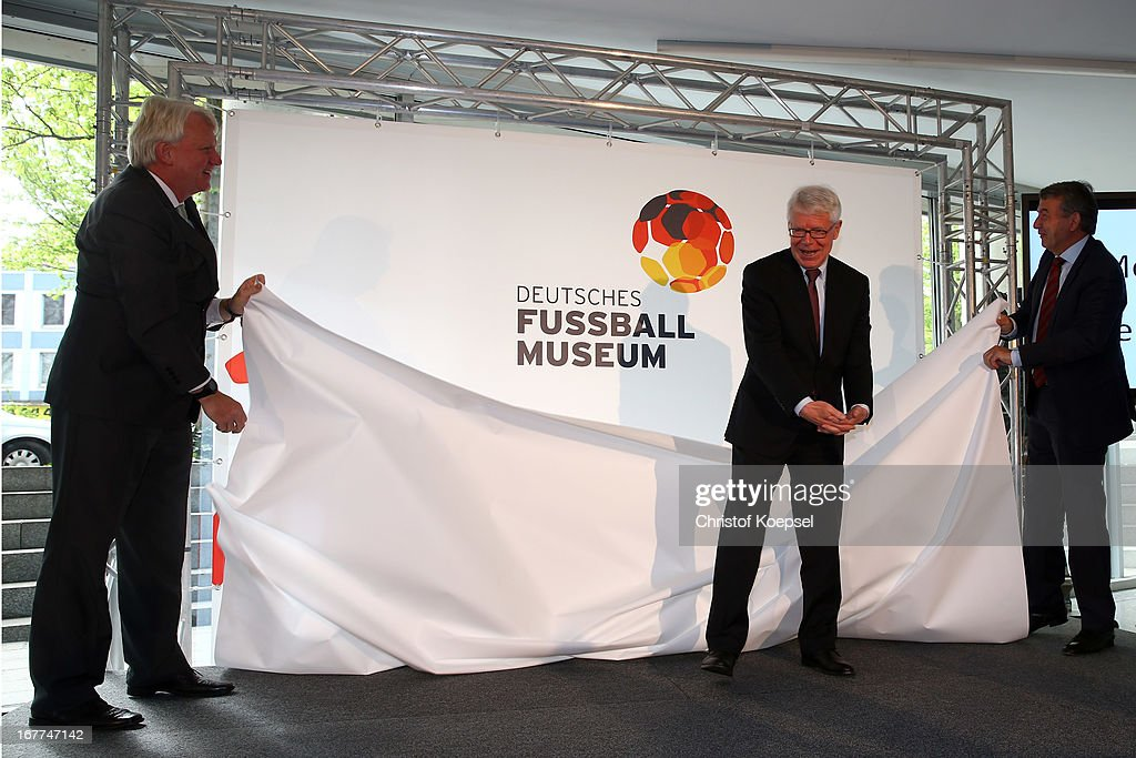 Ullrich Sierau, mayor of Dortmund, Reinhard Rauball, president of the DFL and Wolfgang Niersbach, president of the German Football Association unveil the logo of the DFB Football Museum during the DFB Football Museum groundbreaking ceremony at Harenberg City Center on April 29, 2013 in Dortmund, Germany.