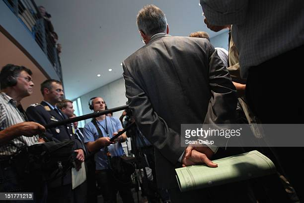 Ulrich Birkenheier president of the German Military CounterIntellgence Service clutches a document while speaking to the media after testifying to...