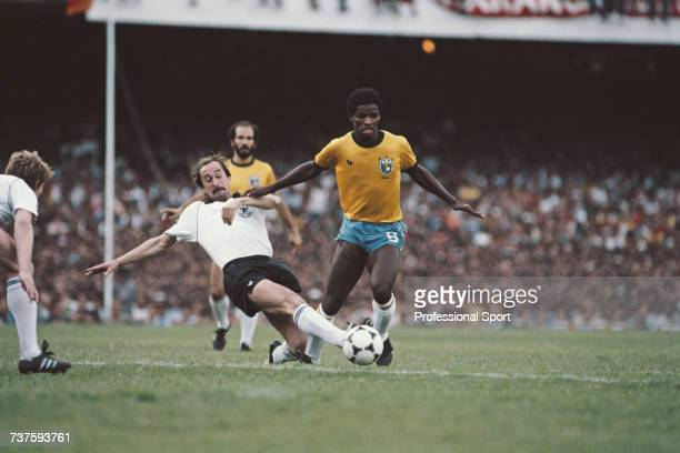 Ulrich Stielike of West Germany stretches to knock the ball away from the feet of Brazilian footballer Adilio during the International friendly match...