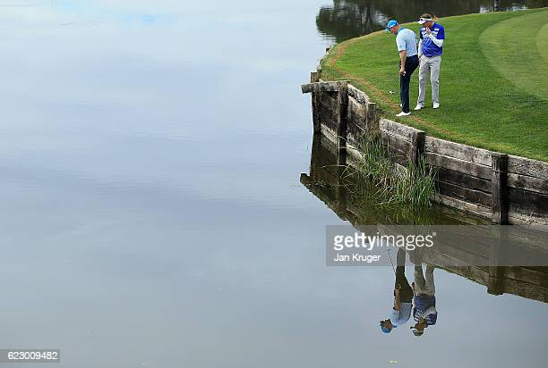 Ulrich van den Berg of South Africa and Steven Tiley of England looks on during the second round of the European Tour qualifying school final stage...