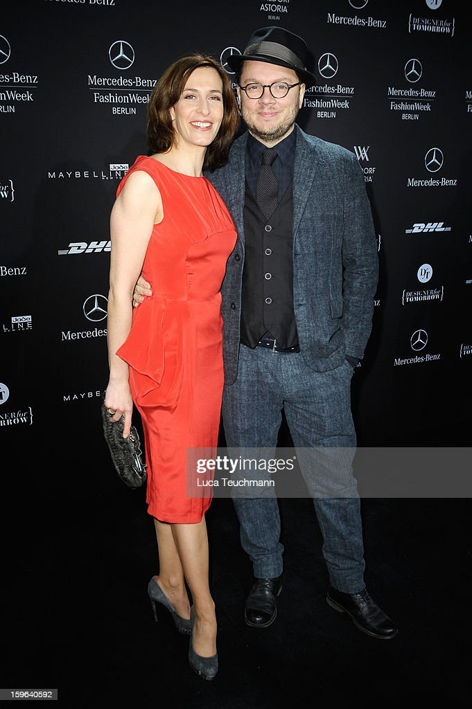Ulrike Frank and Marc Schubring attend Guido Maria Kretschmer Autumn/Winter 2013/14 fashion show during Mercedes-Benz Fashion Week Berlin at Brandenburg Gate on January 17, 2013 in Berlin, Germany.
