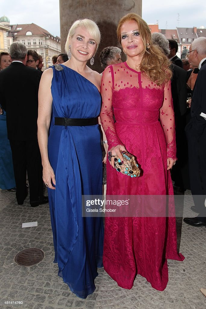 Ulrike Huebner (R) and her daughter Sabina (L) attend the 'Guillaume Tell' Opera Premiere at the Opera Festival Opening In Munich on June 28, 2014 in Munich, Germany.