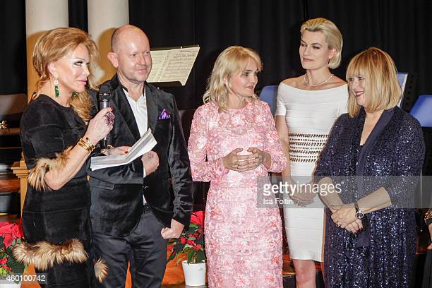 Ulrike Huebner Brian Rennie Claudia GuggerBessinger Kriemhild Siegel and Patricia Riekel attend the Passauer Runde Hosts Christmas Charity on...