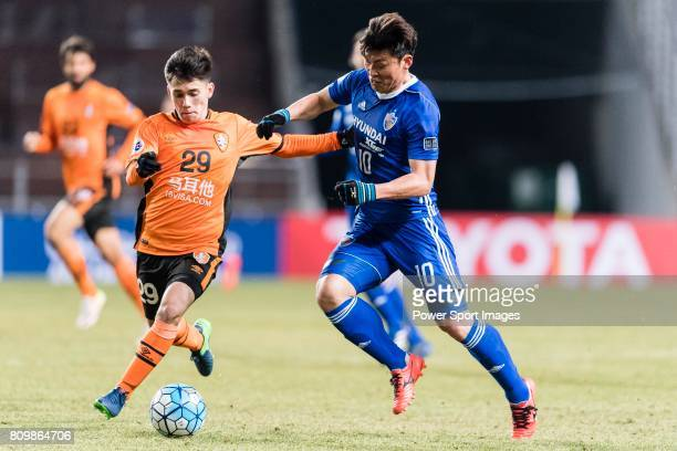 Ulsan Hyundai Forward Lee Jongho fights for the ball with Brisbane Roar Midfielder Joe Caletti during the AFC Champions League 2017 Group E match...