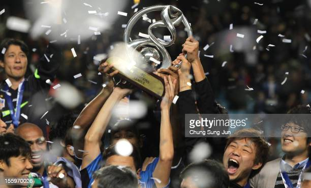 Ulsan Hyundai players celebrate with the AFC Champions League Final Tropy after winning the 2012 AFC Champions League final between Ulsan Hyundai and...