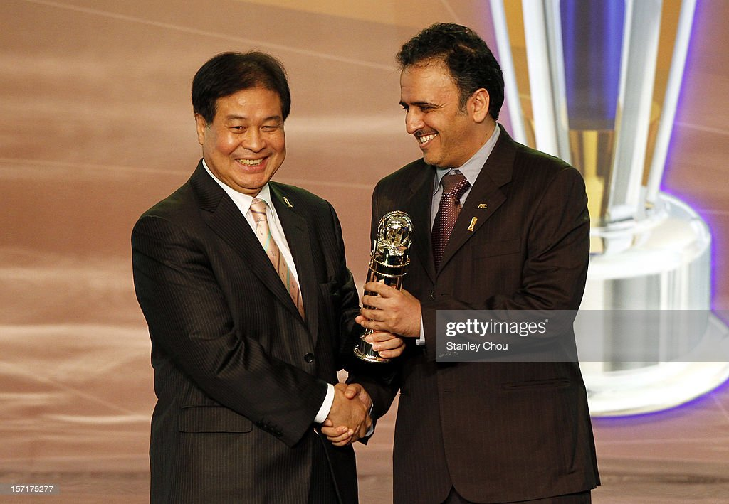 Ulsan Hyundai President Kim Dong-dae collects the 2012 Club Team of the Year award from Dr Hafez Al Medlej, AFC Executive Committee Member and Chairman of the AFC Marketing Committee during the 2012 AFC Annual Awards at the Mandarin Oriental Hotel on November 29, 2012 in Kuala Lumpur, Malaysia.