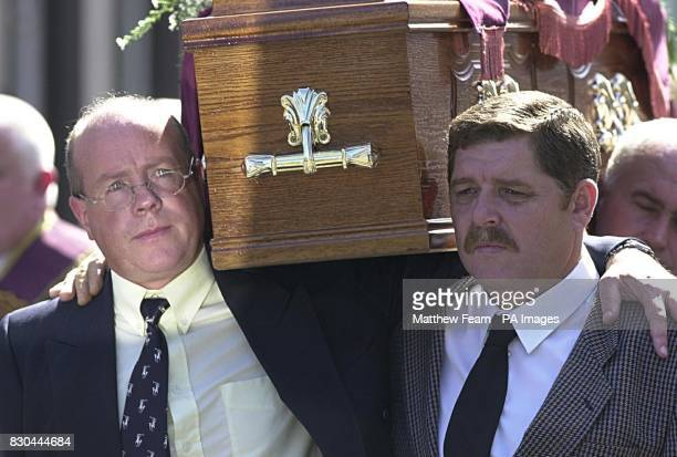 Ulster Democratic Party chairman John White carries the coffin of Bobby Mahood from Snugville Street Belfast Several hundred people gathered for the...