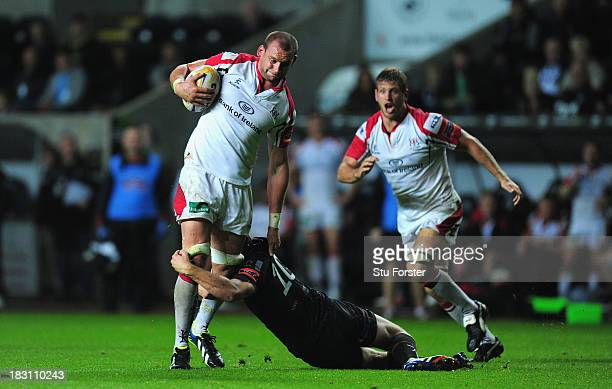 Ulster player Dan Tuohy runs through the tackle of Dan Biggar of the Ospreys during the RaboDirect Pro 12 match between Ospreys and Ulster at Liberty...