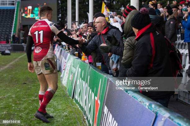 Ulster Rugby fans celebrate with Ulsters Jacob Stockdale at full time during the European Rugby Champions Cup match between Harlequins and Ulster...