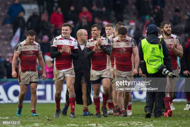 Ulster Rugby players celebrate their victory at full time during the European Rugby Champions Cup match between Harlequins and Ulster Rugby at...