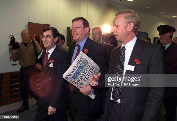 Ulster Unionist leader David Trimble centre with Sir Reg Empey right and party Chairman Lord Rogan leaving a press conference in Belfast Waterfront...