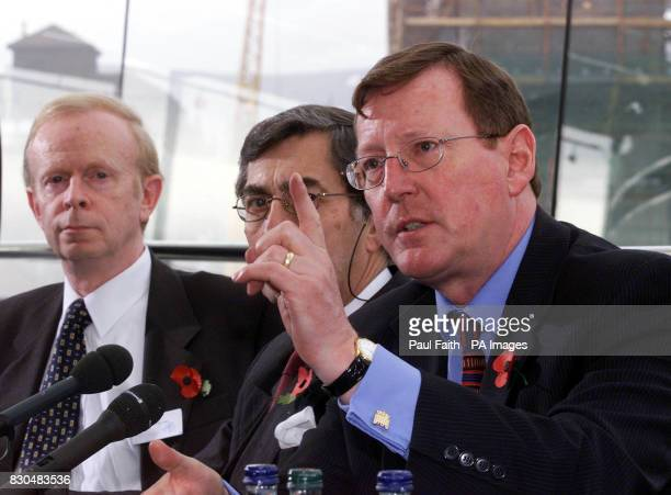 Ulster Unionist leader David Trimble right with Sir Reg Empey left and party Chairman Lord Rogan making his point at a press conference in Belfast...